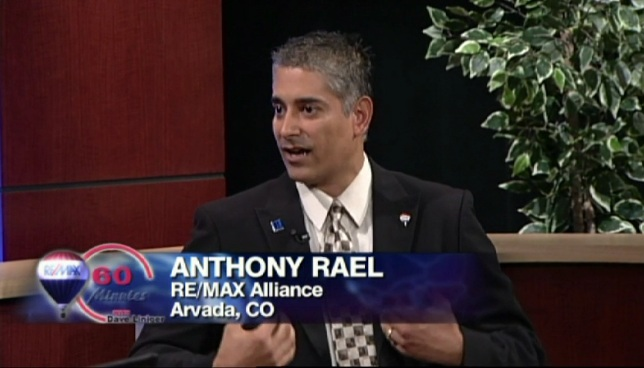 Anthony Rael speaking with RE/MAX CEO Dave Liniger